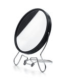Makeup mirror. Black plastic makeup mirror isolated on white Royalty Free Stock Images