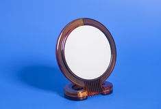 Makeup mirror. On blue background Royalty Free Stock Image