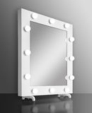 Makeup mirror with bulbs. Isolated on white background. Front view Royalty Free Stock Photos