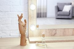 Makeup mirror on table near white wall in room. Makeup mirror on table near white wall in dressing room stock photo