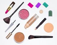 Basic contents of cosmetic bag flat lay. Makeup must haves. Basic contents of cosmetic bag. Concealer stick, foundation, powder, blush, eyeliner, mascara Royalty Free Stock Photo