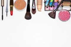 Makeup must haves for modern woman background. Make-up products background. Liquid foundation, loose powder, eyeliner, mascara, eyeshadow, blush, lipstick, basic Stock Photos