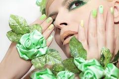 Makeup and nail Polish in green. Stock Image
