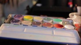 The makeup paints set. Professional multicolored palette brush makeup artist for cinema actor stock video