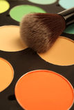Makeup palette and brush Stock Photo
