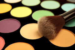 Makeup palette and brush Stock Photos