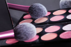Makeup palette and brush reflect in mirror. Royalty Free Stock Images