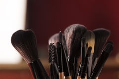 Makeup palette and brushes Stock Images