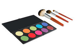 Makeup palette and brushes. Isolated image of makeup palette and brushes Stock Photography