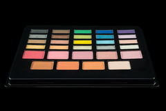 Makeup palette of colorful eyeshadows isolated on black backgrou Stock Images