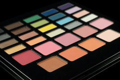 Makeup palette of colorful eyeshadows isolated on black backgrou. Nd Royalty Free Stock Images