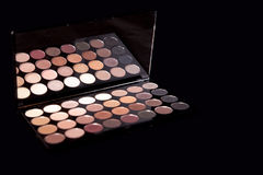 Makeup palette on pure black background. Makeup top popular colors. Royalty Free Stock Image