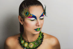 Makeup peacock feathers Royalty Free Stock Photo