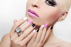 Makeup with pink lips and nail Polish. Royalty Free Stock Image