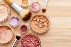 Makeup powder with brushes background stock images