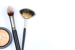 Makeup powder and brushes on white background Royalty Free Stock Photos