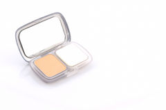 Makeup powder in white case. Stock Photos