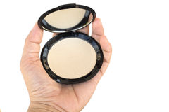Makeup pressed powder in women's hand Royalty Free Stock Photos
