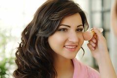 Makeup process Stock Images