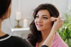 Makeup process. Beauty and makeup. Visagiste at work Stock Photo