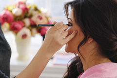 Makeup process. Beauty and makeup. Visagiste at work Stock Image