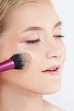 Makeup process of a young pretty girl Royalty Free Stock Photography