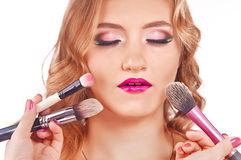 Makeup process of a young pretty girl Stock Images
