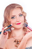 Makeup process of a young pretty girl Royalty Free Stock Image