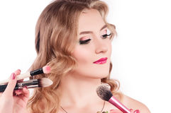 Makeup process of a young pretty girl Stock Photos