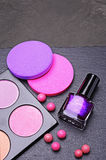 Makeup products or accessories. Blush,  sponges and nail polish. Stock Photos