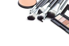 The makeup products. Brush and eyeshadow powder. The makeup products. Brush and eyeshadow powder isolated on white background stock images