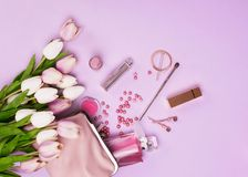 Makeup products with cosmetic bag and flowers Stock Photography