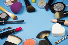 Makeup products. Different makeup products are on blue background Royalty Free Stock Photography