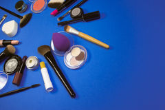 Makeup products. Different makeup products are on dark blue background Stock Photography