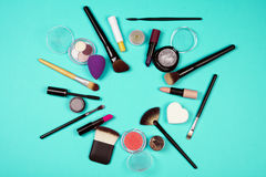 Makeup products. Different makeup products are on turquoise background Stock Image