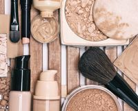 Set of foundation makeup products with professional brushes Stock Image