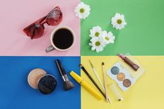Makeup products kvitomy white and coffee on a colored background royalty free stock images
