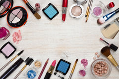 Makeup Products On Wooden Background With Copy Space In Center Royalty Free Stock Images