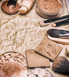 Makeup products to even out skin tone on aged paper frame Royalty Free Stock Photo