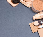 Makeup products to even out skin tone and complexion background Stock Image