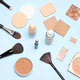 Makeup products to even out skin tone and complexion top view. Makeup products to even out skin tone and complexion: concealer, foundation, cosmetic powder. Top stock image