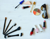 Makeup products on white wooden background with copyspace Royalty Free Stock Photography