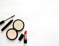 Makeup products on wooden background. With copy space Stock Photography