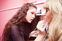 Makeup professional at work Royalty Free Stock Photography