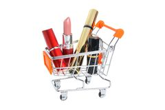Makeup in pushcart isolated on white Royalty Free Stock Image
