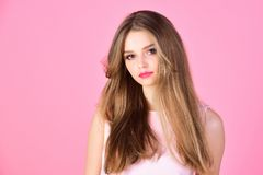 Makeup for sensual model with soft skin. Fashion look concept. girl with makeup and healthy hair. Beauty and hairdresser. Salon. woman with long hair on pink royalty free stock photography