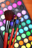 Makeup set. Colorful makeup eye shadows and natural brushes Stock Photography