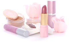Makeup set. With soap roses, lipsticks, powder, sticks of eye shadows Royalty Free Stock Images