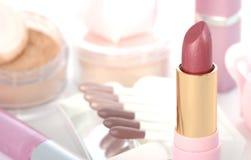 Makeup set. With soap roses, lipsticks, powder, sticks of eye shadows Stock Photo