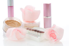 Makeup set. With soap roses, lipsticks, powder, sticks of eye shadows Royalty Free Stock Photography